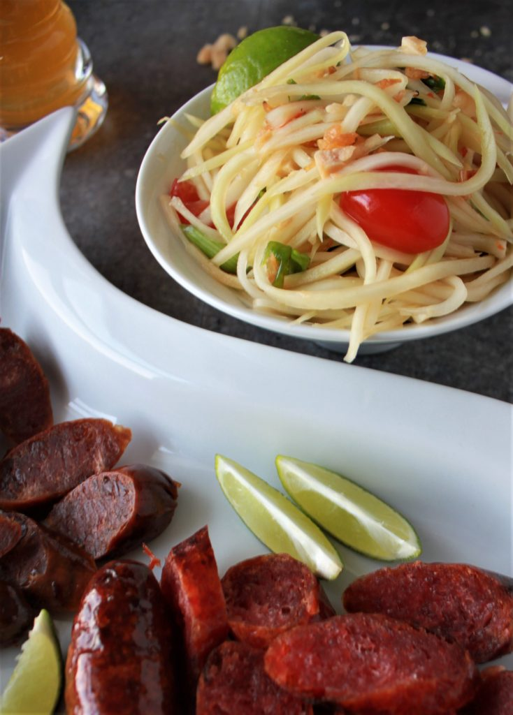 green papaya salad and Chinese sausage paired with IPA
