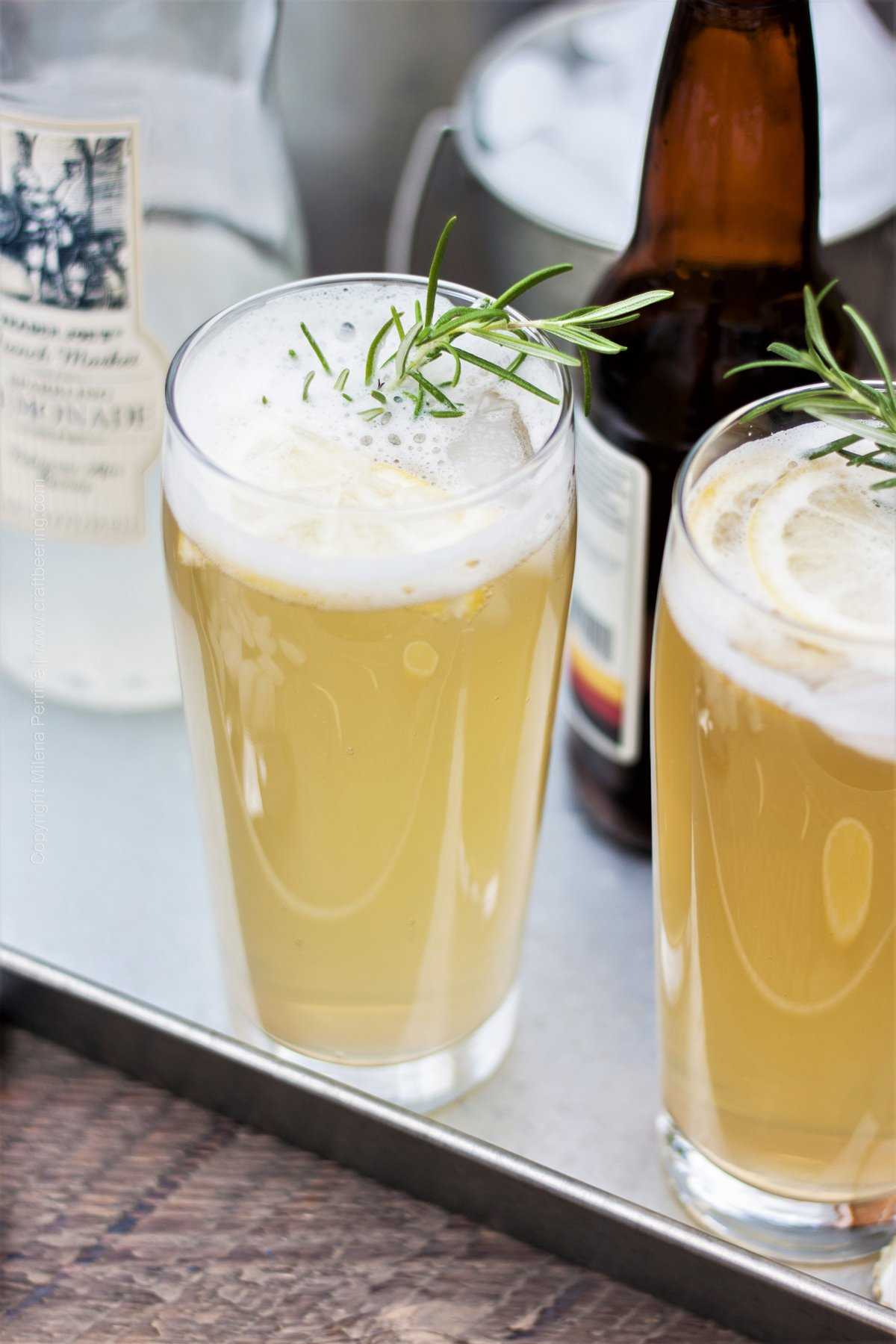 Radler Bier with Pilsner and Sparkling Lemonade. Garnish with rosemary and lemon slices for extra refreshing flavors.