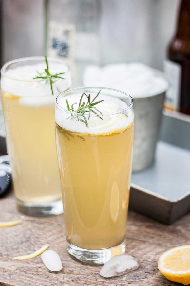 Radler with Rosemary and Lemon Garnish. Half Pilsner, half sparkling lemonade.
