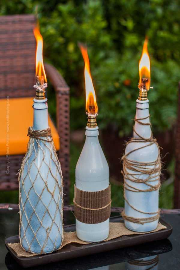 Beer bottle tiki torches arrangement