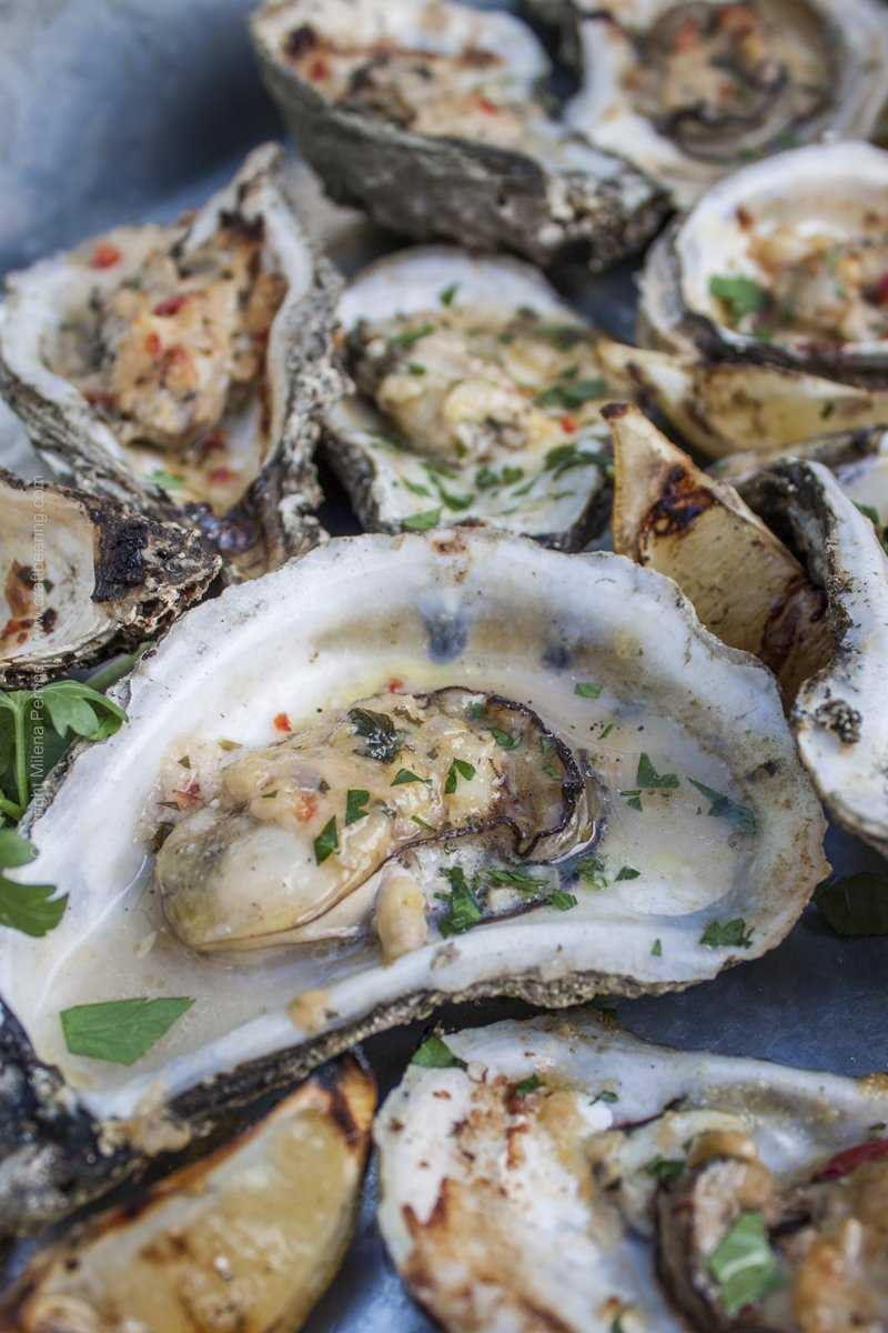 Smoked chargrilled oysters with butter compound.