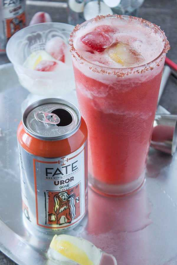 Strawberry Sorbet gose margarita with lemon and strawberry ice cubes, Hawaiian alaea pink salt