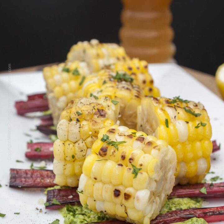 Grilled Swiss chard and corn bites with parsley pesto, paired with IPA.