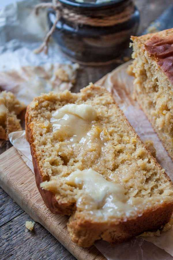 Peach ale breakfast loaf slice with melting honey butter