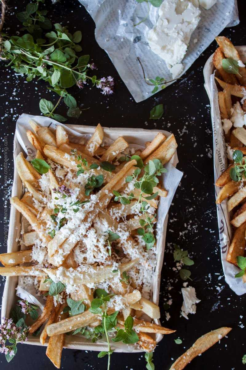 Hand cut fries with feta cheese and fresh oregano. #handcutfries. Perfect beer snack.