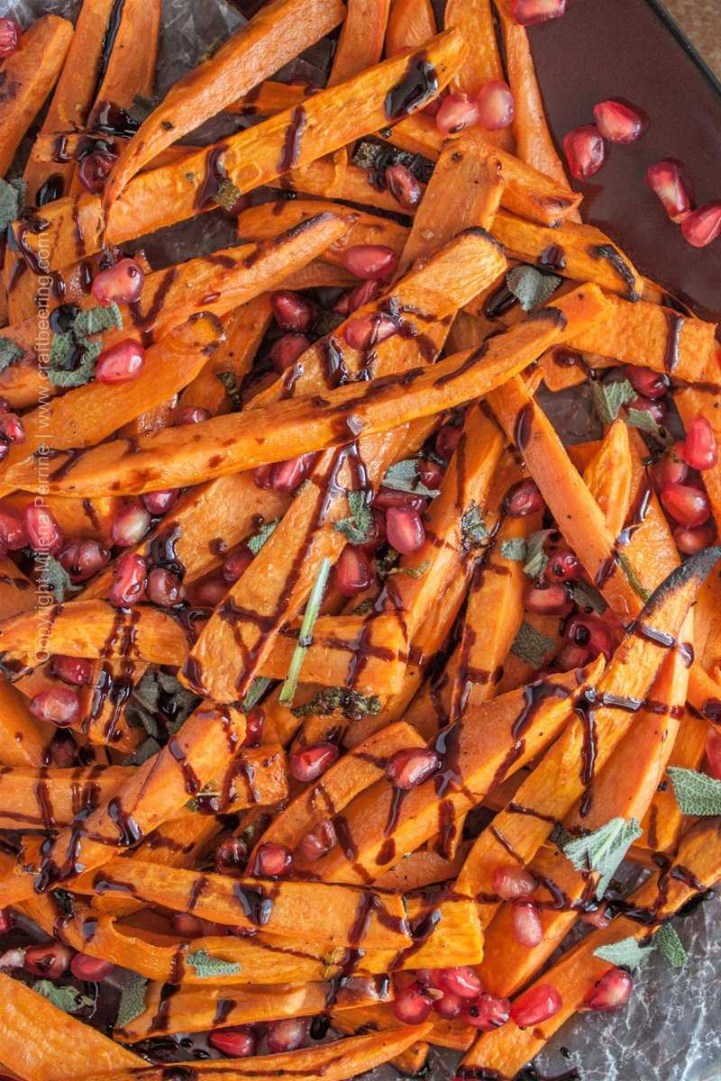 Saison butter sweet potato fries with sage and pomegranate. Drizzled with balsamic reduction. #sweetpotatofries #saisonbutter #saisonbuttersweetpotatofries