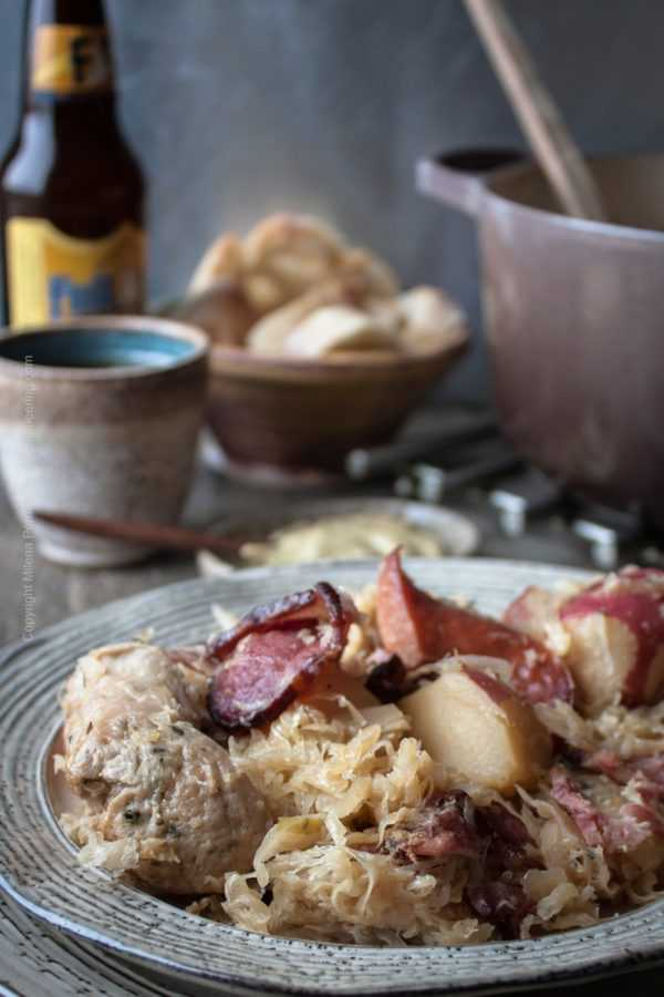 Choucroute garnie with smoked charcuterie and spices, served with brown mustard and bread. And balanced or malty beer.