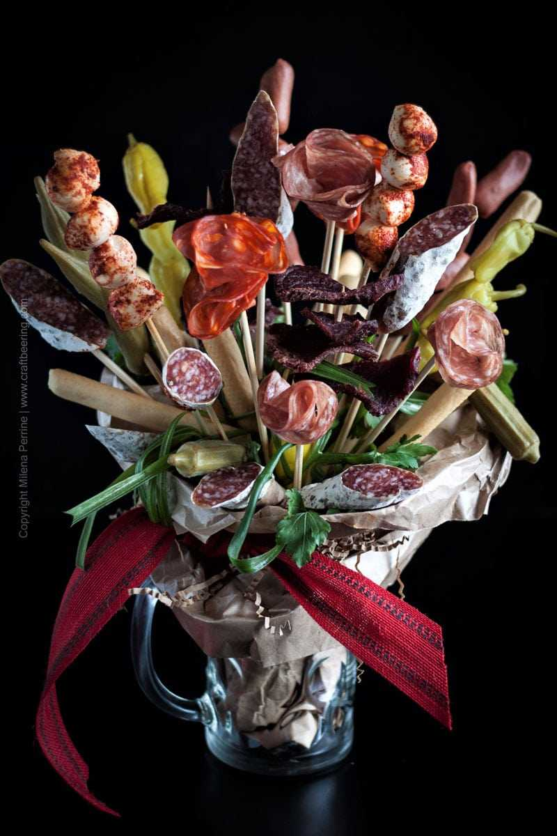 Charcuterie Bouquet. Salami flowers:) and bread sticks for your man. Or woman. Salami bouquet also = a beer lover's dream gift. #beerlovergift #charcuteriebouquet #salamibouquet #ediblebouquet #manflowers
