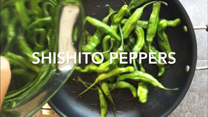 Toss the shishito peppers in the hot oil pan to blister them