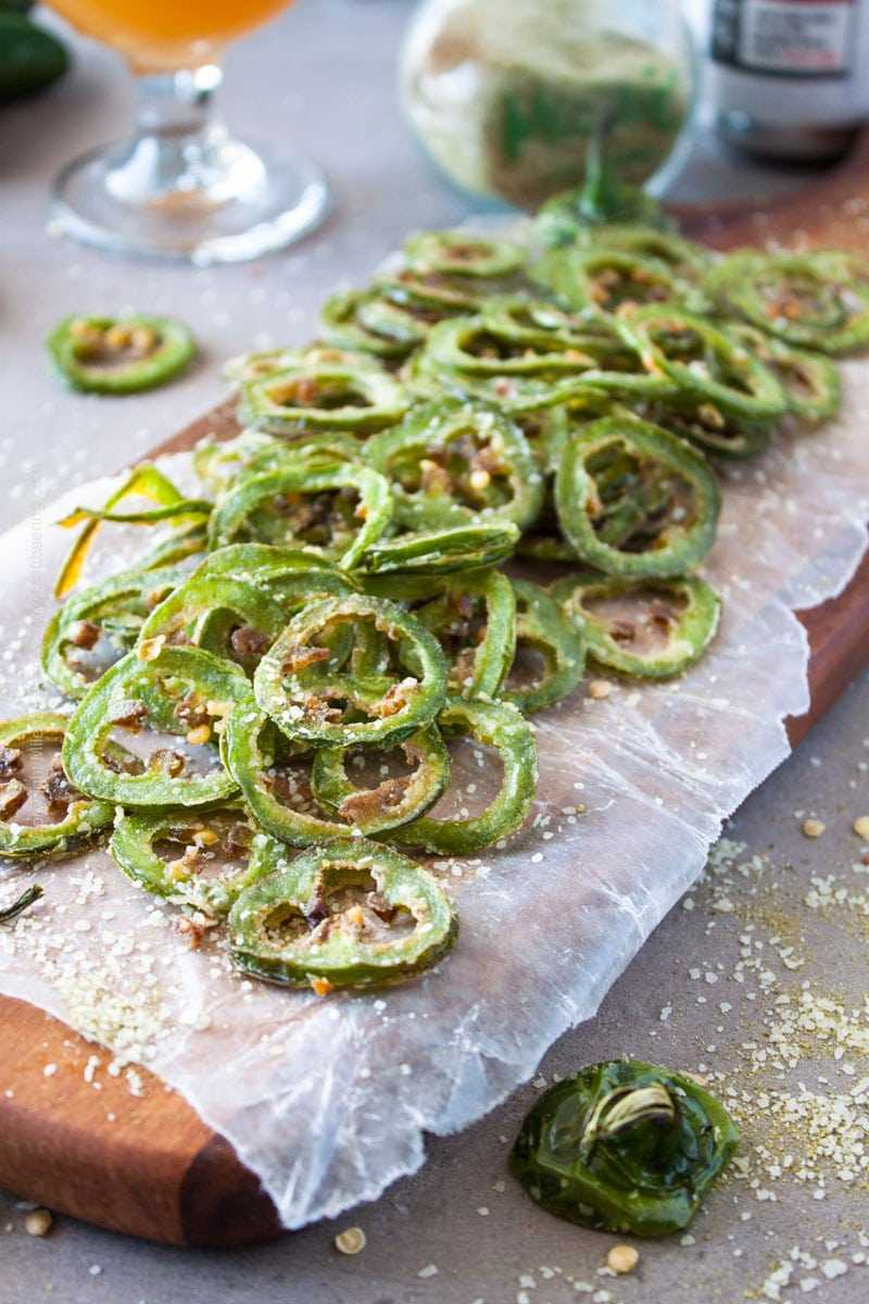 Fried Jalapenos recipe. These fried jalapenos are thinly sliced, lightly dusted with flour then briefly immersed in hot frying oil and finished with hops salt. #friedjalapenos #jalapenos #Jalapenosrecipe
