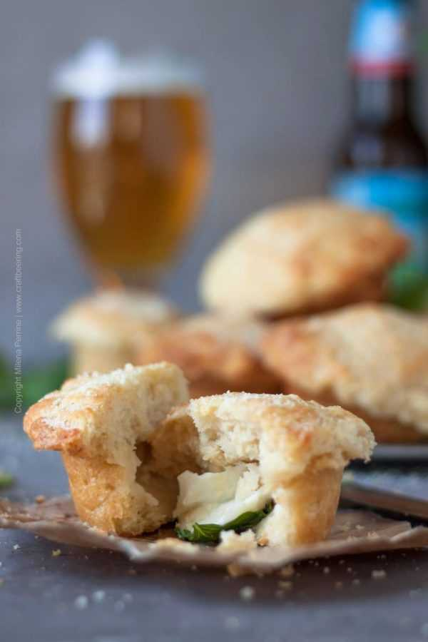Beer muffins with Parmesan in the batter. Delightful airy texture, moist and crusty. Stuffed with Mozzarella and basil. Easy and quick. #beermuffins #easymuffins #beerbattermuffins #beerbread #cookingwithbeer