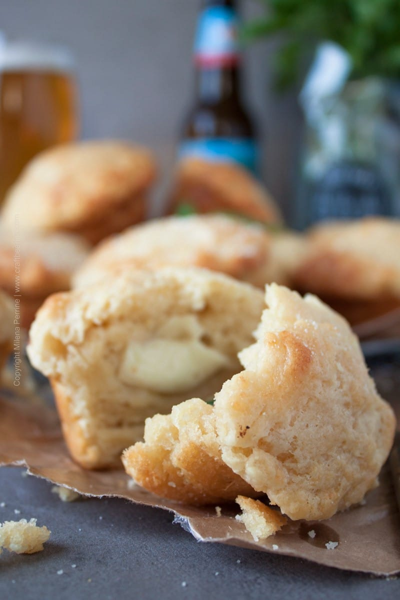 Savory beer muffins with Parmesan in the batter. Delightful airy texture, moist and crusty. Stuffed with Mozzarella and basil. Easy and quick. #beermuffins #easymuffins #beerbattermuffins #beerbread #cookingwithbeer