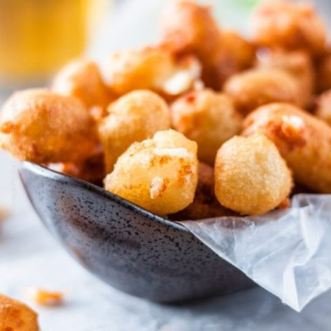 Stretchy inside and crispy outside. Bowlful or beer battered cheese curds