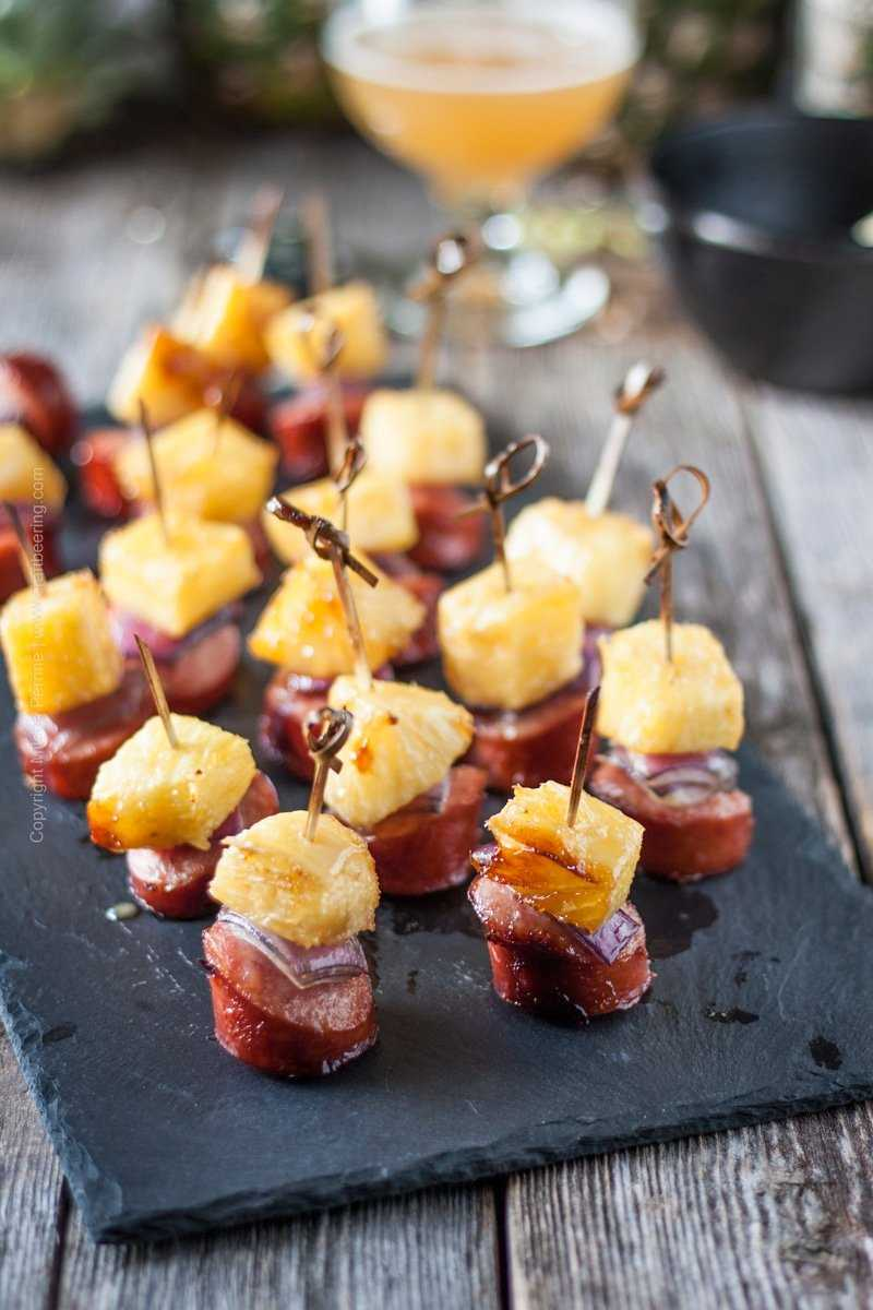 Decadent pineapple sausage bites. Perfect hors d'oeuvre for large or small parties. #appetizer #summerrecipe #pineapplesausage #pineapple #cocktail #snack
