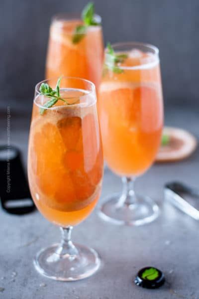 Grapefruit beer shandy filled glasses with a fresh mint and pink grapefruit garnish. Awesome summer shandy recipe. #craftbeer #beercocktails #grapefruitbeer #summershandy