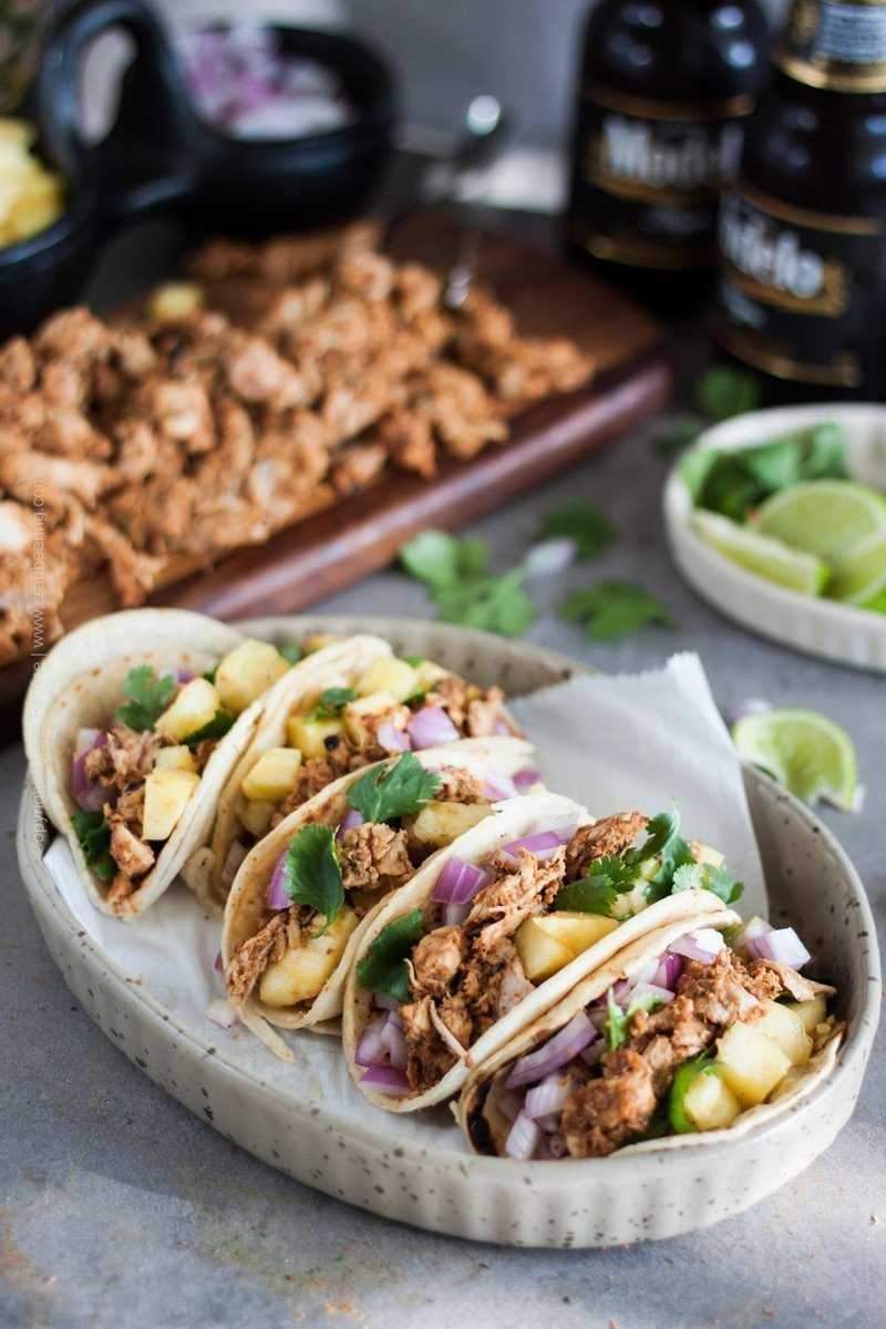 Tacos al Pastor | Learn how to make delicious, tender pork al pastor on the grill or cast iron grill skillet every time. The flavors are unbeatable. #tacos #porktacos #alpastor #pineapplesauce #achiote