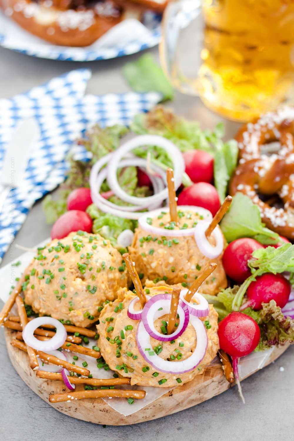 Oktobefest Brotzeit platter with soft Bavarian pretzel and obazda.