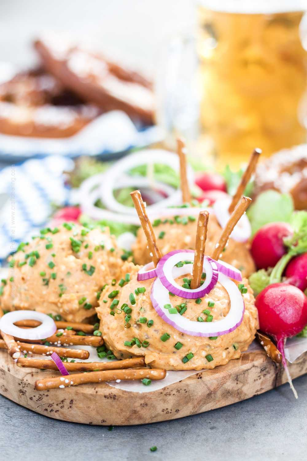 Obatzda cheese dip balls with pretzels, radishes, onions and Bavarian lager.