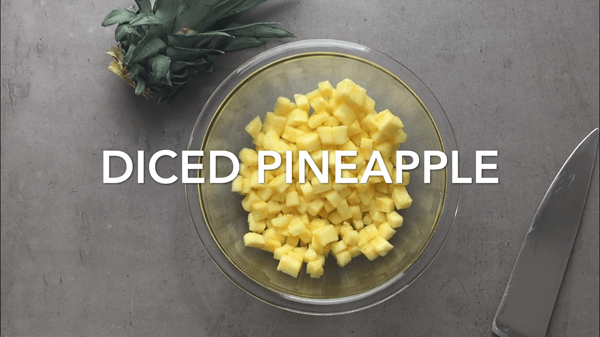 Diced fresh pineapple in a bowl - the key ingredient for pineapple salsa.