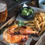 Half roast chicken served with cucumber salad and fries. Juicy meat, crispy skin. Classic Oktoberfest fare.