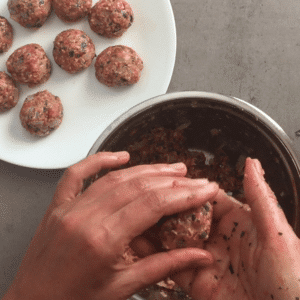 Frikadellen shape mixture into patties or meatballs