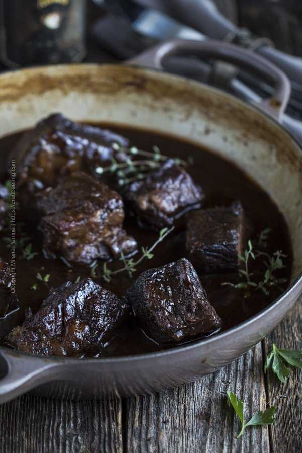 Beer braised short ribs, shown with the bones removed and in a rich gravy made from the braising liquid.