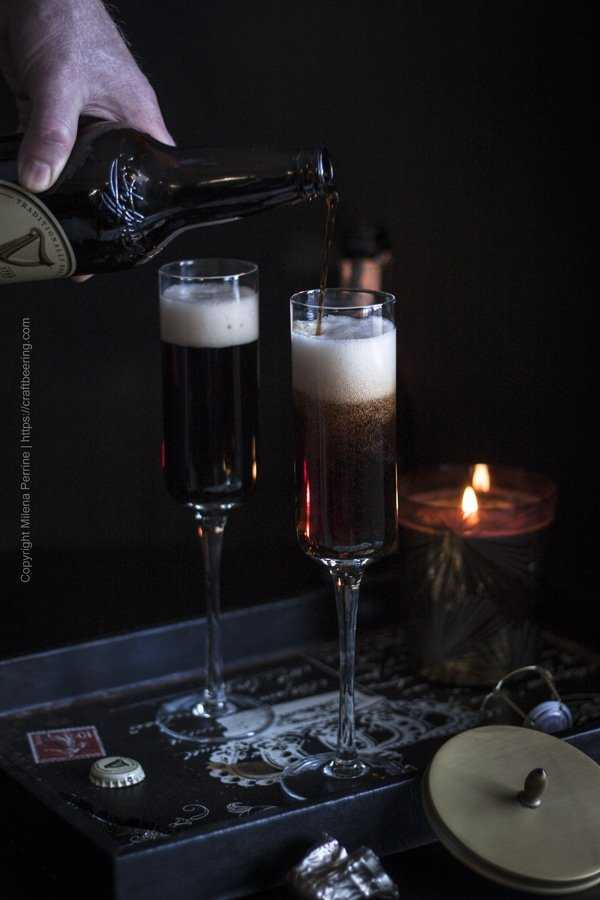Black Velvet cocktail - pouring Guinness on top of champagne