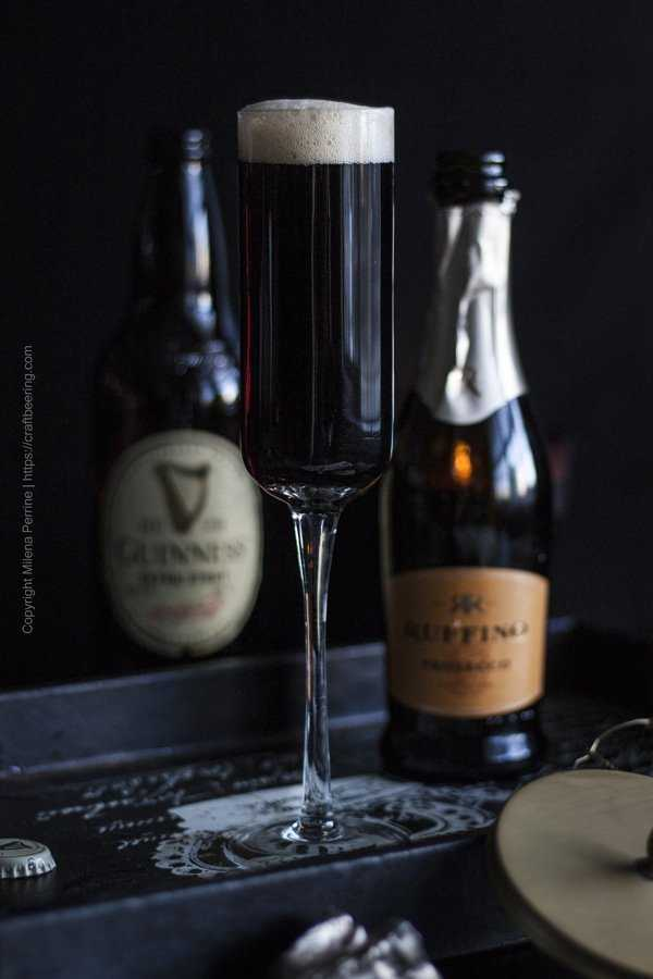 Black Velvet Cocktail in a champagne flute.