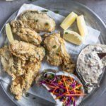 Pan fried oysters served with sherry vinaigrette coleslaw and remoulade.