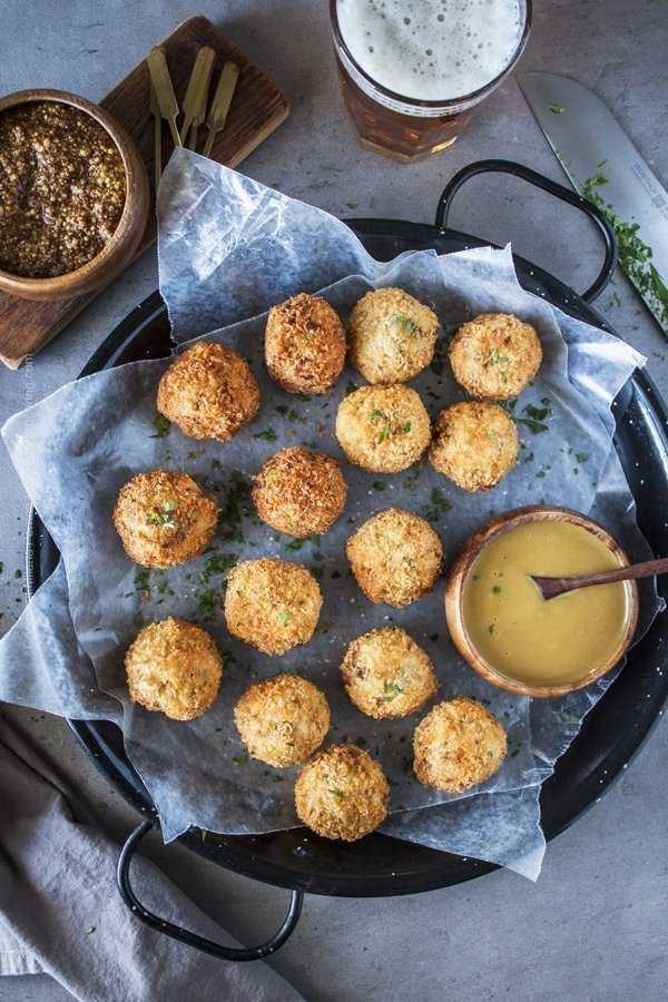 Sauerkraut fritters, ball shaped, with beer mustard and honey mustard.
