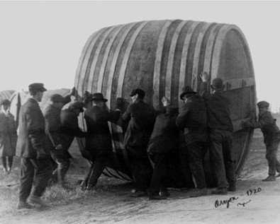Vintage beer art print showing men rolling a vat of beer in Oregon circa 1920.