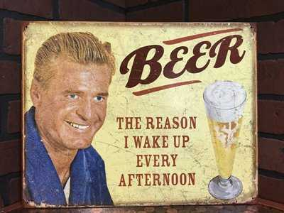 Beer is the reason I wake up every afternoon. Funny beer sign.