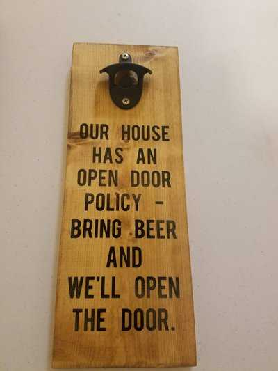 Open door policy funny beer sign made of wood.