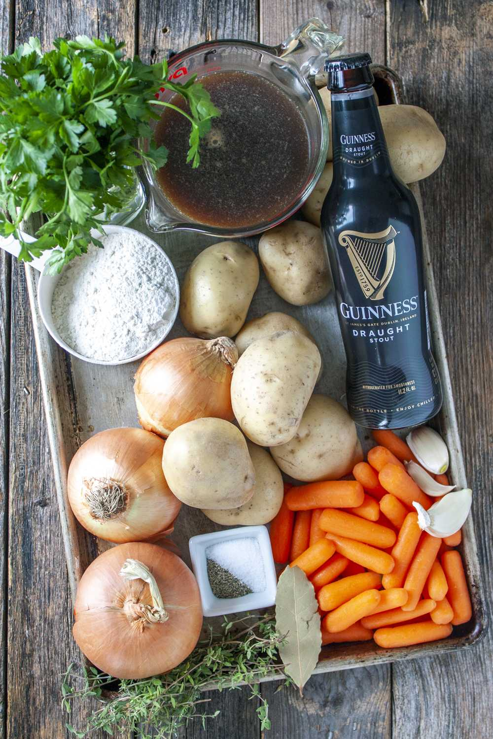 Traditional ingredients for Irish stew - carrots, potatoes, onions, Guinness etc. .