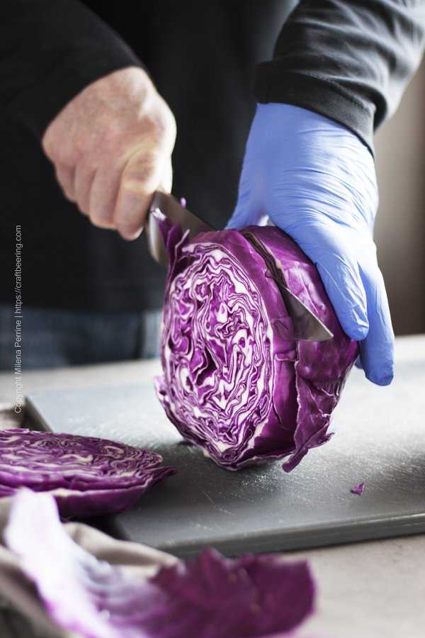 Roasted red cabbage streaks begin with slicing a head of cabbage into wheels.