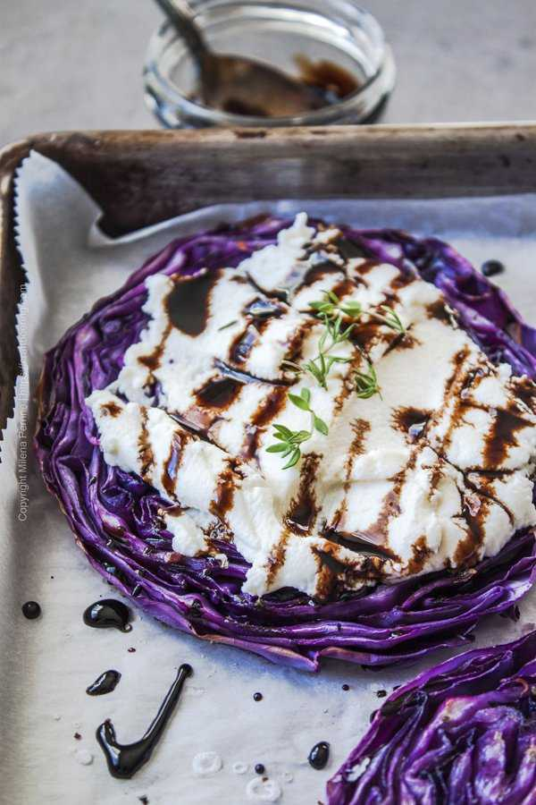 A roasted cabbage steak slathered with a thick layer of ricotta and drizzled with beersamic reduction.