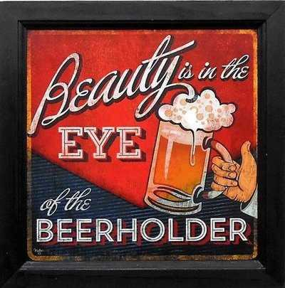 Beauty is in the eyes of the beerholder vintage beer sign.