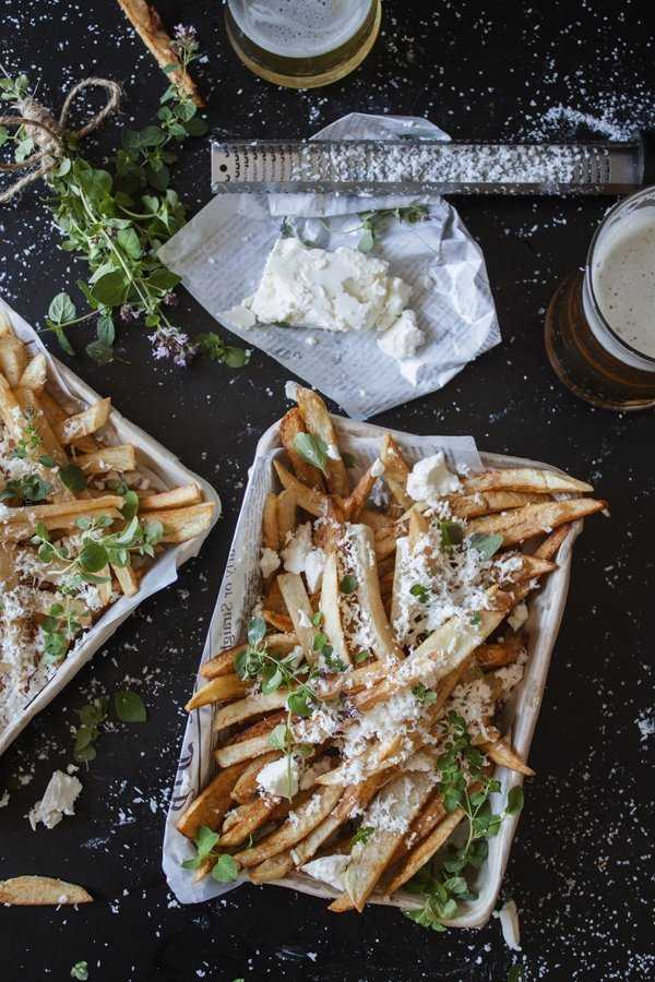 Fries, feta cheese, oregano and crisp lagers create a symphony of flavors - taste and aroma are potent and contrasting mouthfeel is at play.