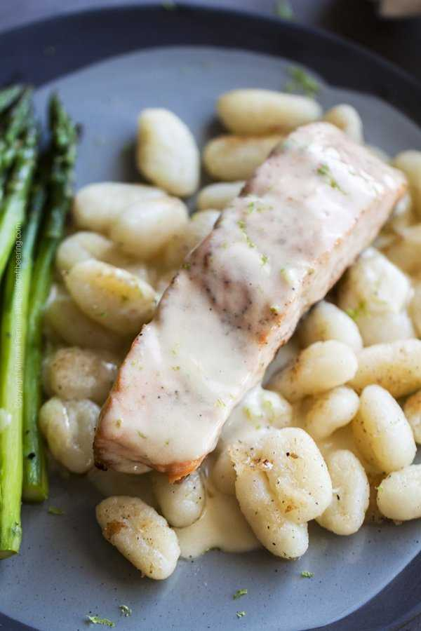 Pan seared salmon fillet served with gnocci, asparagus and gose beurre blanc sauce.