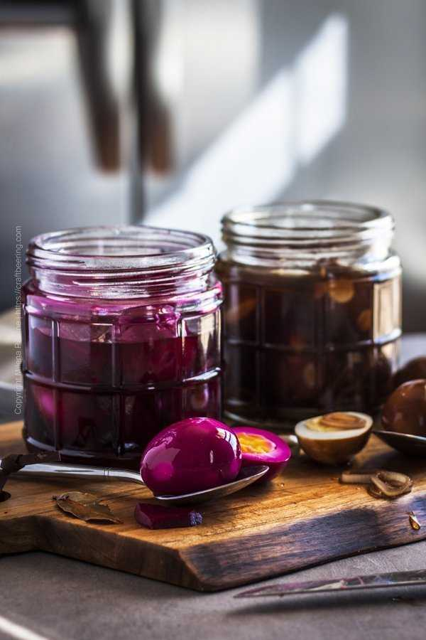 Jars with beet pickled eggs and balsamic spicy pickled eggs.