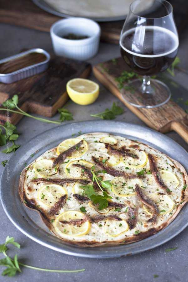 Anchovies pizza with thinly sliced lemons, onions and creme fraiche.