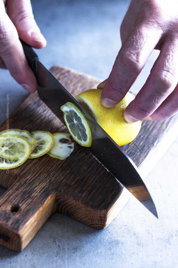 Slicing lemons in very thin, almost see through slices.