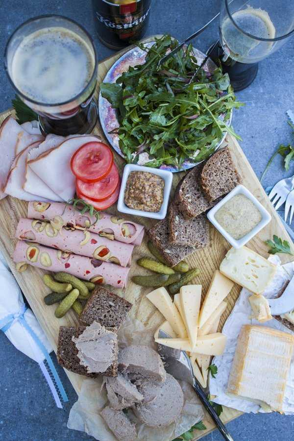 German appetizers - a meat and cheese board featuring popular German choices like Li,burger and leberwurst.