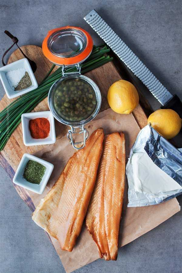 Ingredients and tools for smoked trout dip layed out on a cutting board