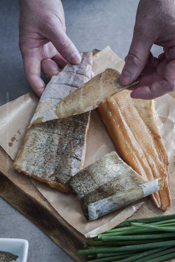 Demonstration on how to easily peel off the skin of a smoked trout fillet.