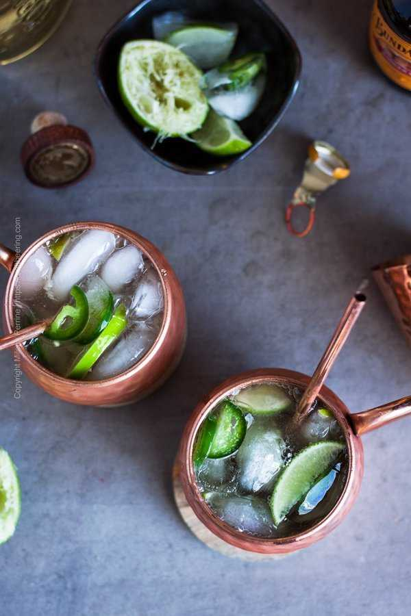 Tequila mule cocktail in the signature hammered copper mugs, viewed from above.
