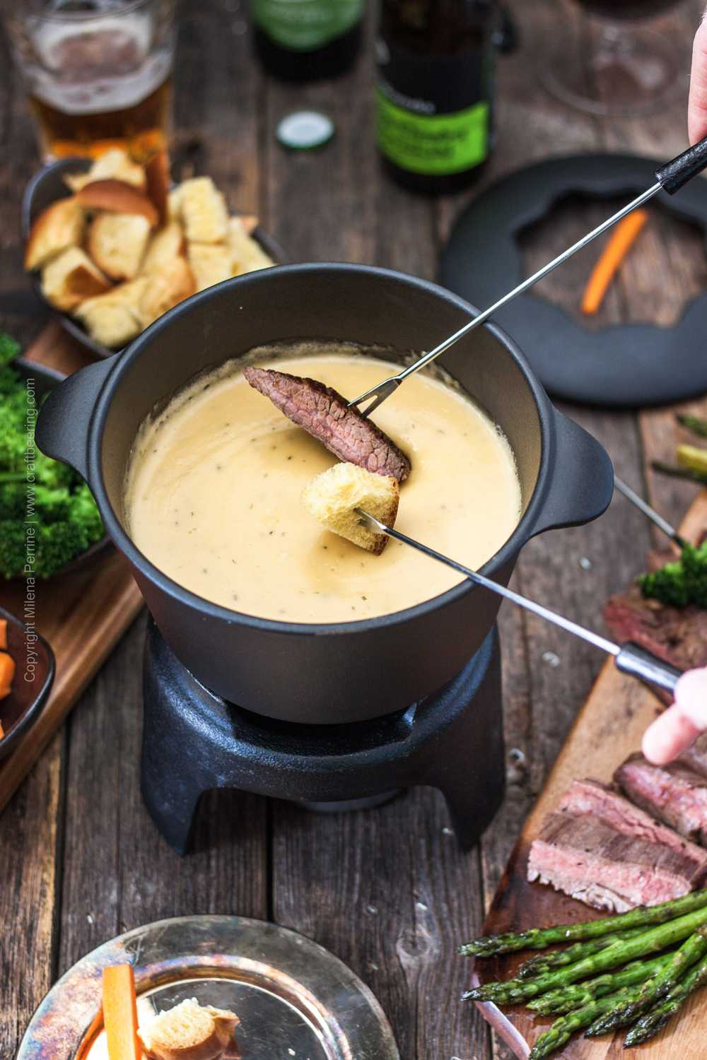 Fondue pot with beer cheese melted to perfection.