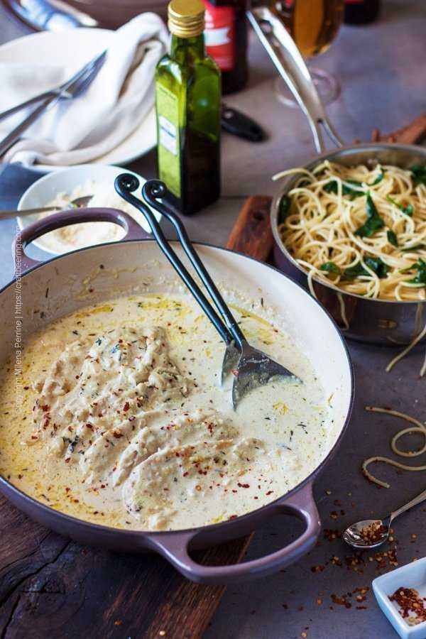 Chicken cutlets in a creamy Parmesan shallots sauce, served with spinach garlic spaghetti.