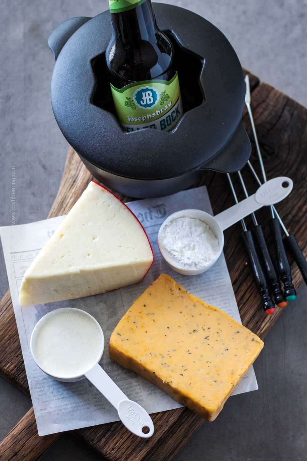 Beer cheese fondue simple ingredients - melting cheeses, malty lager, flour an heavy cream.