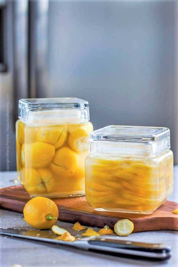 Preserved lemons - a jar of whole and a jar of sliced.